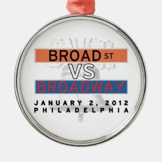 Calle amplia CONTRA el ornamento de Broadway Ornato