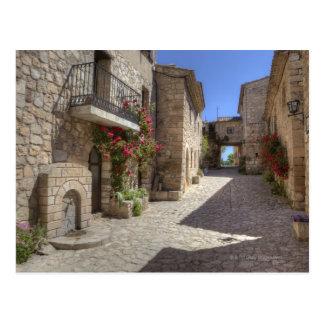 Calle del guijarro, edificios de piedra, tarjeta postal