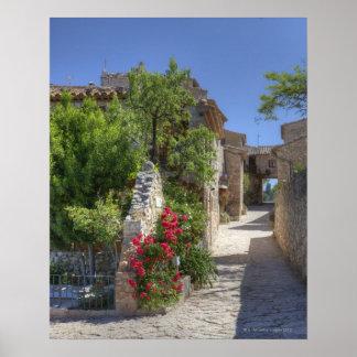 Calles del guijarro, edificios de piedra póster