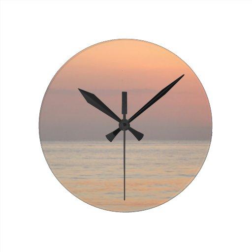 calm ocean round clock