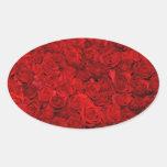 Cama de rosas rojos calcomanía óval