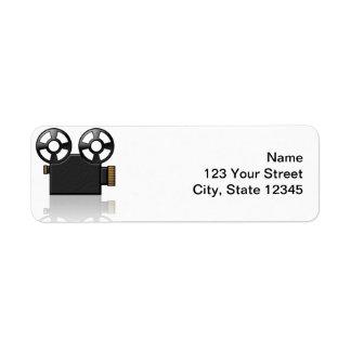 Cámara de película en negro y oro en blanco etiqueta de remite
