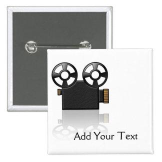 Cámara de película en negro y oro en blanco pin