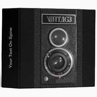 Cámara del vintage en una carpeta para las fotogra