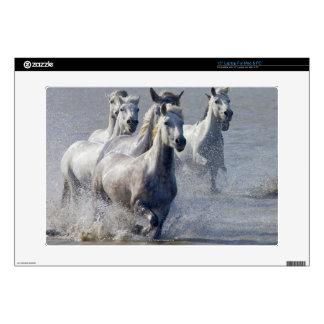 """Camargue horses running on marshland to cross skin for 15"""" laptop"""