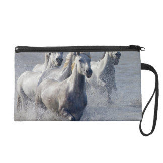 Camargue horses running on marshland to cross wristlet purse