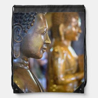 Camboya, Phnom Penh. Estatuas de Buda Mochilas