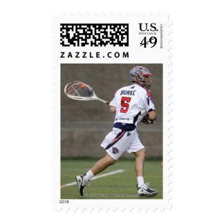 CAMBRIDGE, MA - AUGUST 13:  Jordan Burke #5 2 Stamps