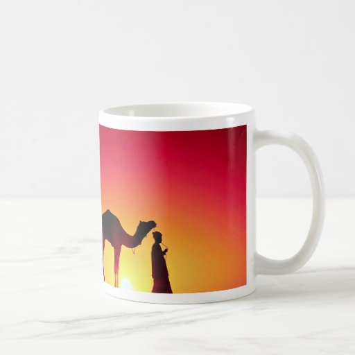 Camel and driver at sunset, India Coffee Mugs