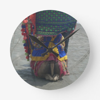 Camel on the toes.png round clock