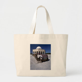 Camel resting in front of dome Monastir Tunisia Canvas Bags