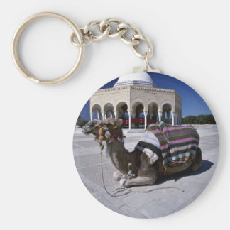 Camel resting in front of dome Monastir Tunisia Keychains