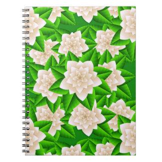 Camelias y hojas blancas del verde libretas