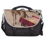 Camello y coche bolsas de portatil