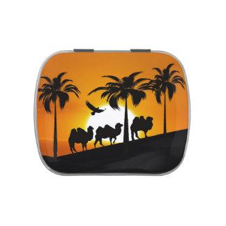 Camellos del desierto en la puesta del sol jarrones de caramelos