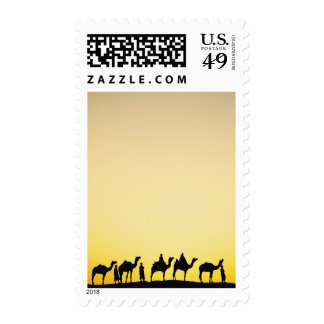 Camels and camel driver silhouetted at sunset, 4 postage stamp