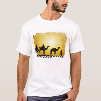 Camels and camel driver silhouetted at sunset, T-Shirt