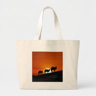 Camels at sunset large tote bag