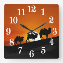 Camels at sunset square wall clock