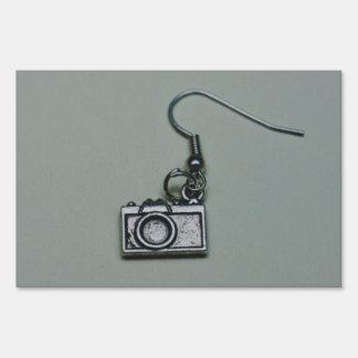Camera earring macro sign