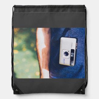 Camera Themed, A Man Carrying Pocket Camera By Han Drawstring Backpack