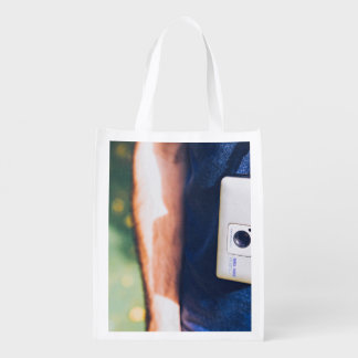 Camera Themed, A Man Carrying Pocket Camera By Han Grocery Bags