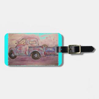 camión azul antiguo de la pátina etiquetas de maletas