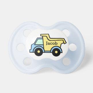 Camión volquete azul y amarillo chupete