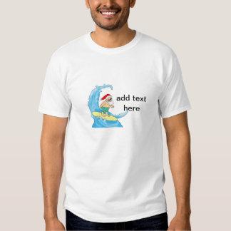 Camiseta de Santa que practica surf Polera