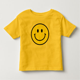 Camiseta feliz del niño de la cara playeras