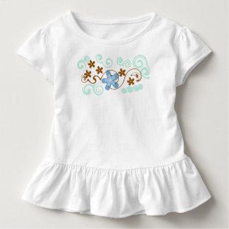 Camiseta floral del volante del niño