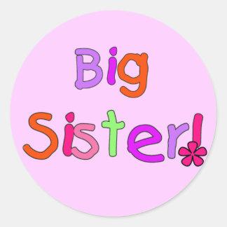Camisetas y regalos de la hermana grande pegatina redonda
