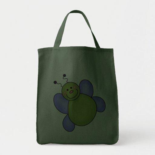 Camisetas y regalos sonrientes azules y verdes del bolsa