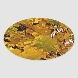 CAMOUFLAGE WITH LEAVES IN LATE FALL OVAL STICKER