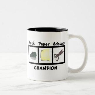 Campeón de papel de las tijeras de la roca taza de café