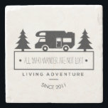 "Camping Wanderlust | Travel Quotes RVing Retired Stone Coaster<br><div class=""desc"">Rustic travel decor for home on the road with your RV is this philosophical camping stone coaster featuring a classic vintage travel trailer silhouette surrounded by pine trees. Reads All who wander are not lost in black below in whimsical letters. In curved text, it reads LIVING ADVENTURE below that and...</div>"