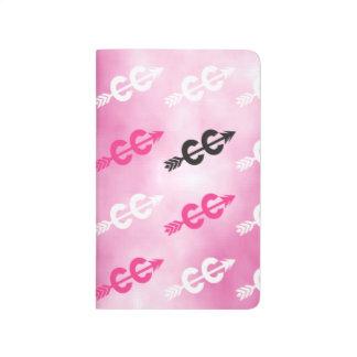Campo a través rosado cuadernos grapados