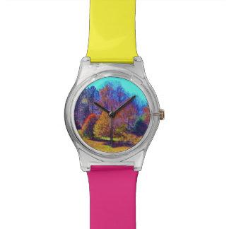 Campo coloreado del arco iris de árboles relojes de mano