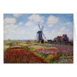 Campo de Monet de tulipanes con la tarjeta de feli