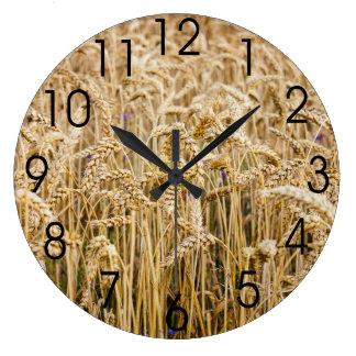 Campo del trigo, granos de oro reloj redondo grande