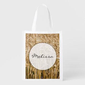 Campo del trigo, granos de oro bolsas para la compra