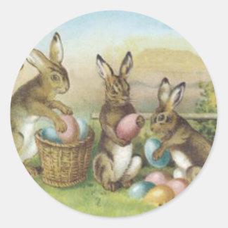 Campo pintado coloreado del huevo del conejito de pegatina redonda