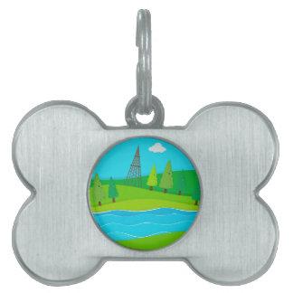 Campo verde por el río placas de nombre de mascota