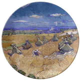 Campos de trigo con el segador de Vincent van Gogh Plato De Cerámica