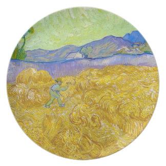Campos de trigo con el segador en la salida del so platos