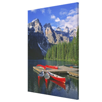 Canada, Alberta, Moraine Lake. Red canoes await Canvas Prints