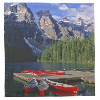 Canada, Alberta, Moraine Lake. Red canoes await Cloth Napkin