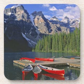 Canada, Alberta, Moraine Lake. Red canoes await Coaster