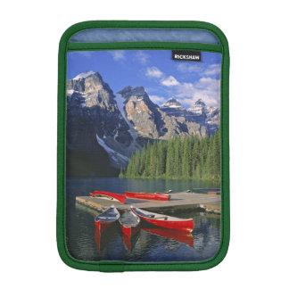 Canada, Alberta, Moraine Lake. Red canoes await iPad Mini Sleeve