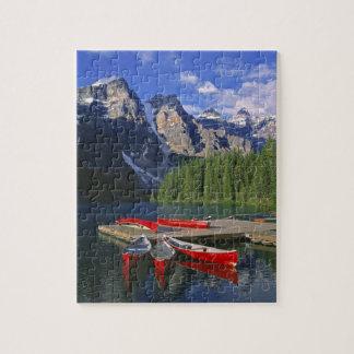 Canada, Alberta, Moraine Lake. Red canoes await Jigsaw Puzzle